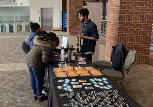 students at sign-in table